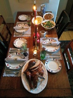 Here is my table in Providence, set for Thanksgiving dinner. It may not be Martha Stewart, but I though it was looked appropriate for the New England setting.