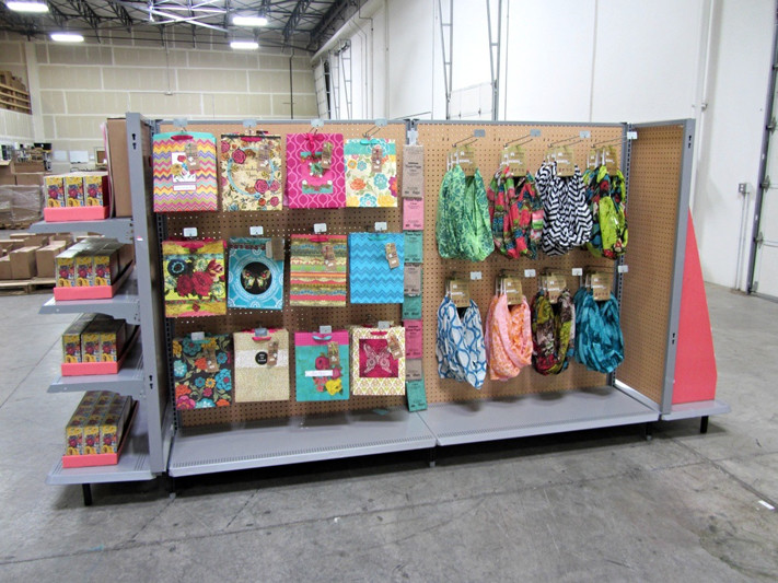 Here is the Full Circle Exchange island in the rough, standing in the warehouse, before shipping out.  Gift bags are on the left, scarves on the right.