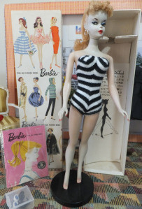 In 1959, you bought the Barbie and then collected the clothes.  See the illustrated panel?  You could buy all those clothes in individual packets, sans doll.