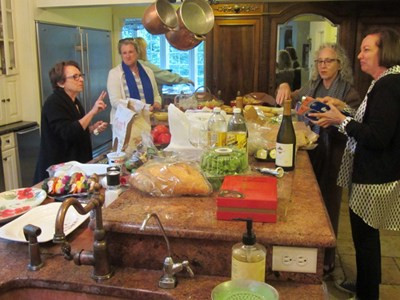 Jeanne Sullivan, Anne Ravanona, Iva Kaufman, and Valarie Gelb cook up world change while preparing dinner.
