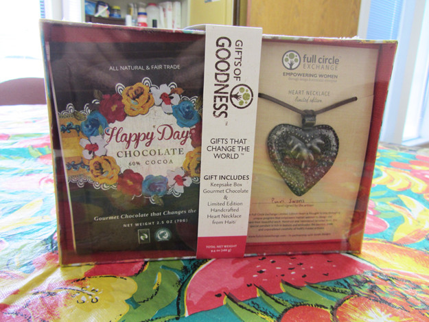 The product for Mother's Day on the small table in the break room at Dream Chocolate.  The chocolate benefits women locally in Boise; the heart necklace is made in Haiti.