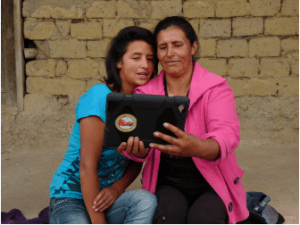 María Briyith Fuquen & Johanna Fuquen, Cómbita, Colombia. Joahnna teaches her mother how to read and  save using the Lista App, a financial eductions tool,  on the tablet.