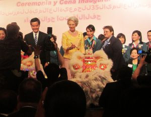 Princess Benedikte of Denmark and CY Leung, chief executive of Hong Kong government, sign a triumvirate of comic dragons who pranced into the conference opening..