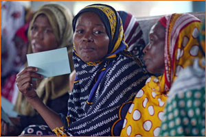These women are in a savings program in Tanzania, run by CARE.