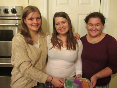 Who says the young don't care about women's issues?  Donnetta's daughter Lucy (center) and her friends were making soaps for their girls' self-esteem campaign right in the same kitchen with all of us.