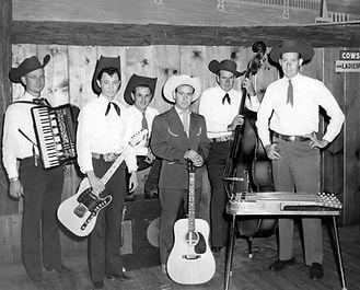 "SHORTY JOE c.1954  Shorty Joe & his Red Rock Canyon Cowboys Left to right: Henry A. ""Hank"" Doust, Jr., accordion; Larry Dean Black, electric guitar; Tulio ""Steve"" Stefani, drums; ""Shorty Joe"" Quartuccio, leader, acoustic guitar, & vocals; Melvin ""Mel"" Twilligear, bass & vocals; William ""Bill"" Tonnensen, steel guitar."