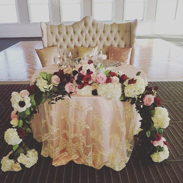 Sweetheart Table with Floral Garland
