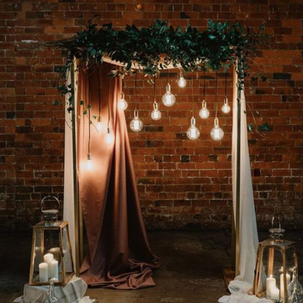 Industrial Style Greenery Arbor RENTAL mwith draping and added industrial lighting