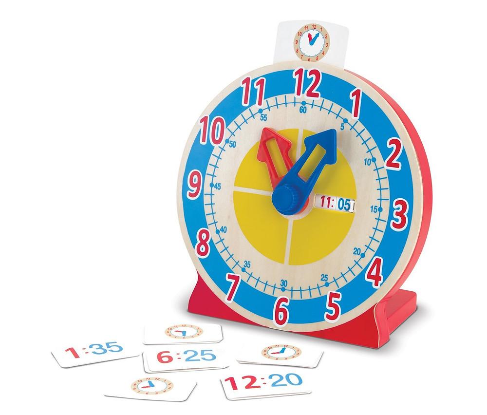 Melissa & Doug - Reloj para girar y ver la hora