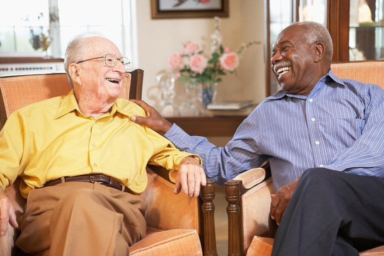 Senior-men-relaxing-in-armchairs-1482122