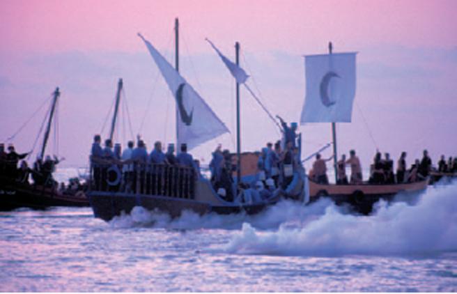 The pirate fleet attacks Villajoyosa beach. Image via Creative Commons