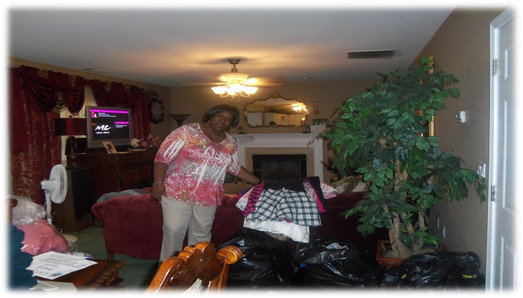 Linda Carmichael helping to prepare for S.T.A.N.D.'s first garage sale.