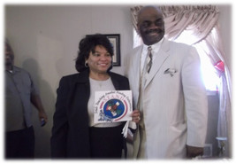 Vernaye and Paster Clifford McGrady at the dedication of the first home.