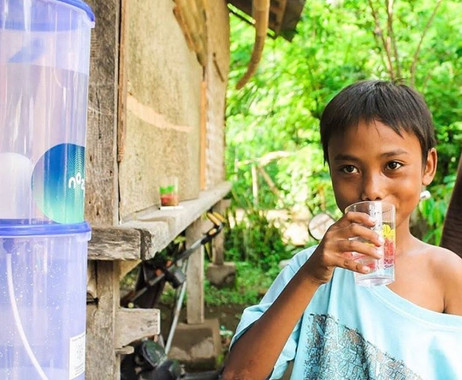 Child enjoying water sponsored by Creations for a Cause!