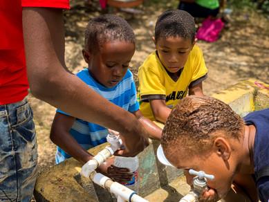 Kids enjoying water from our trip to San Juan, Puerto Rico after Hurricane Maria.
