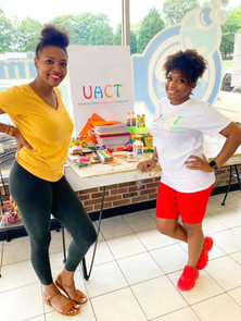 Ebony and Founder Tamadj collecting school supplies at the Give-A-Load event for our back to school drive!