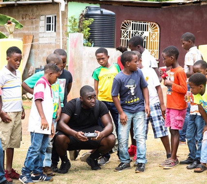Justin from Moor Life Travel hanging with some of the kids in the community in San Juan, Puerto Rico.