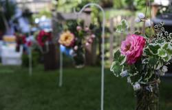 Outdoor ceremony aisle flowers