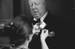 Pinning boutonniere for wedding ceremony