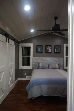 Vaulted ceiling in master bedroom, custom closet doors