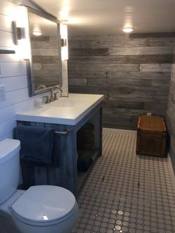 Custom built vanity with repurposed wood