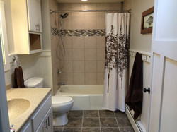 Bathroom renovation, new tile floors, vanity, shower walls and added beadboard accent