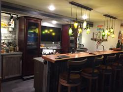 Very modern bar in basement