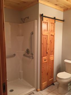 Added handicapped shower, sliding linen closet barn door