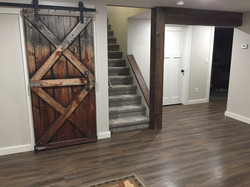 Barndoor into storage room, wrapped beam in barnwood