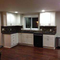 Modern kitchen update with cabinets and slate tile backsplash