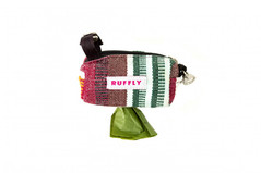 Handmade dog poop bag holder featuring handwoven fabric and stainless leash clip