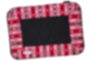 Handwoven dog bed with waterproof bottom in striking red, black, and white pattern