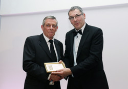a team member picks up the award for Antonio Rosa of the Coppid Beech hotel, bronze for Front-of-Hou