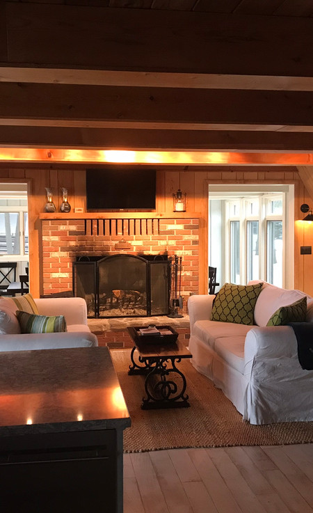 Bright sitting area with fireplace.