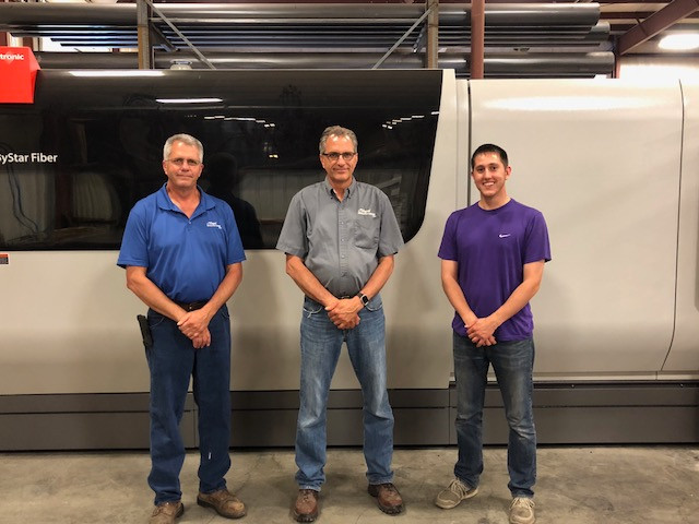 Mark, Don and Lincoln Slagel pose in the shop area of Slagel Manufacturing last week / CIFN photo.