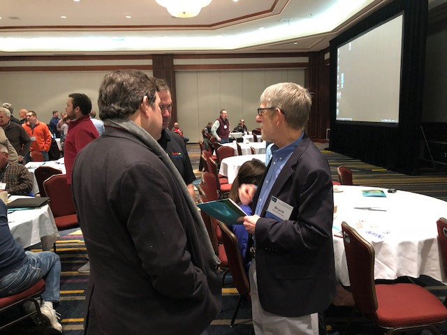 Bryce Knorr of Farm Futures, right, at this week's Soybean Summit in Springfield / CIFN photo.