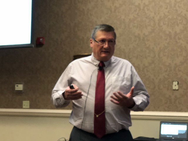 Merrill Crowley addresses a market meeting in Bloomington last winter / CIFN file photo.