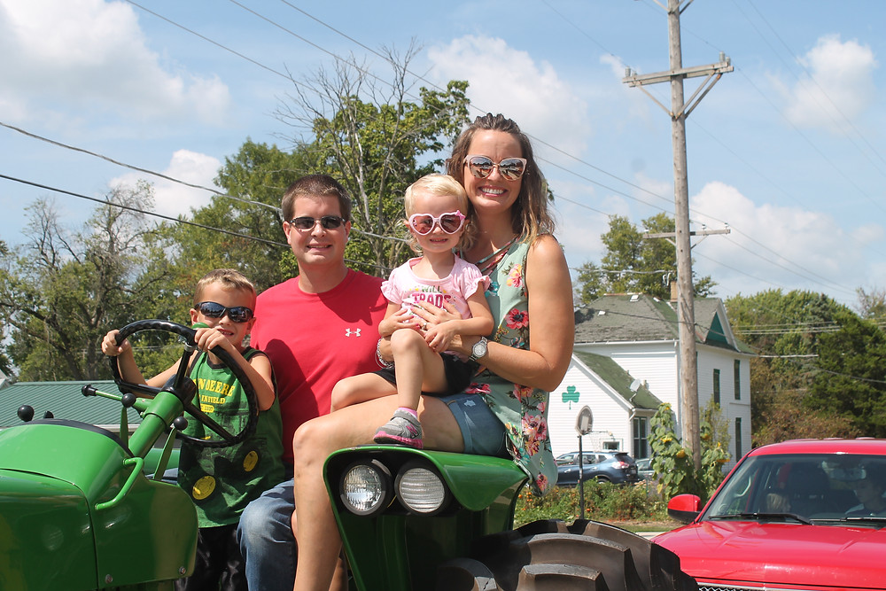The Casson family rides in the annual Threshermen's Parade through Pontiac / CIFN photo.