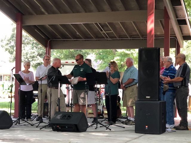 State Rep. Dan Brady presents a resolution to Mayor David Slagel during the Marsh Park re-dedication ceremony on Saturday / EOCI photo.