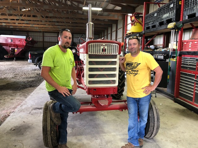 Dagan (left) and Derek Brucker pose in their shed near Cropsey last week / CIFN photo.