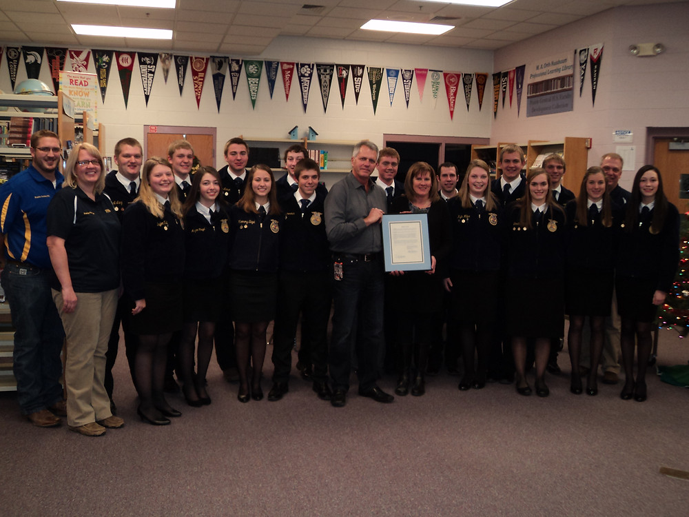 PC FFA members are presented with a resolution from the school board / CIFN photo.