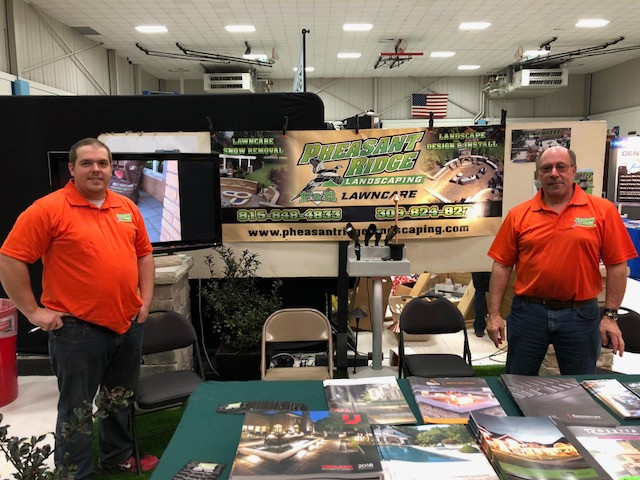 Brett Fehr, left, and Roger Gramm, right, oversee the Pheasant Ridge Landscaping/F&R Lawncare booth at the PC FFA Farm and Home Show / EOCI photo.