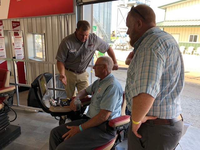 Visitors to the Farm Progress Show try out new technology from Case IH / CIFN photo.