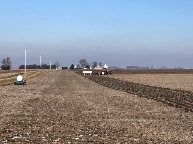 Anhydrous tanks and an applicator are parked in an area field Sunday / CIFN photo.