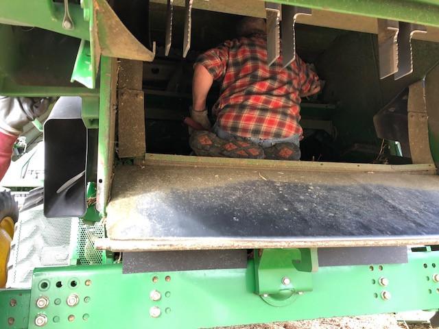 A farmer works on his combine / CIFN photo.