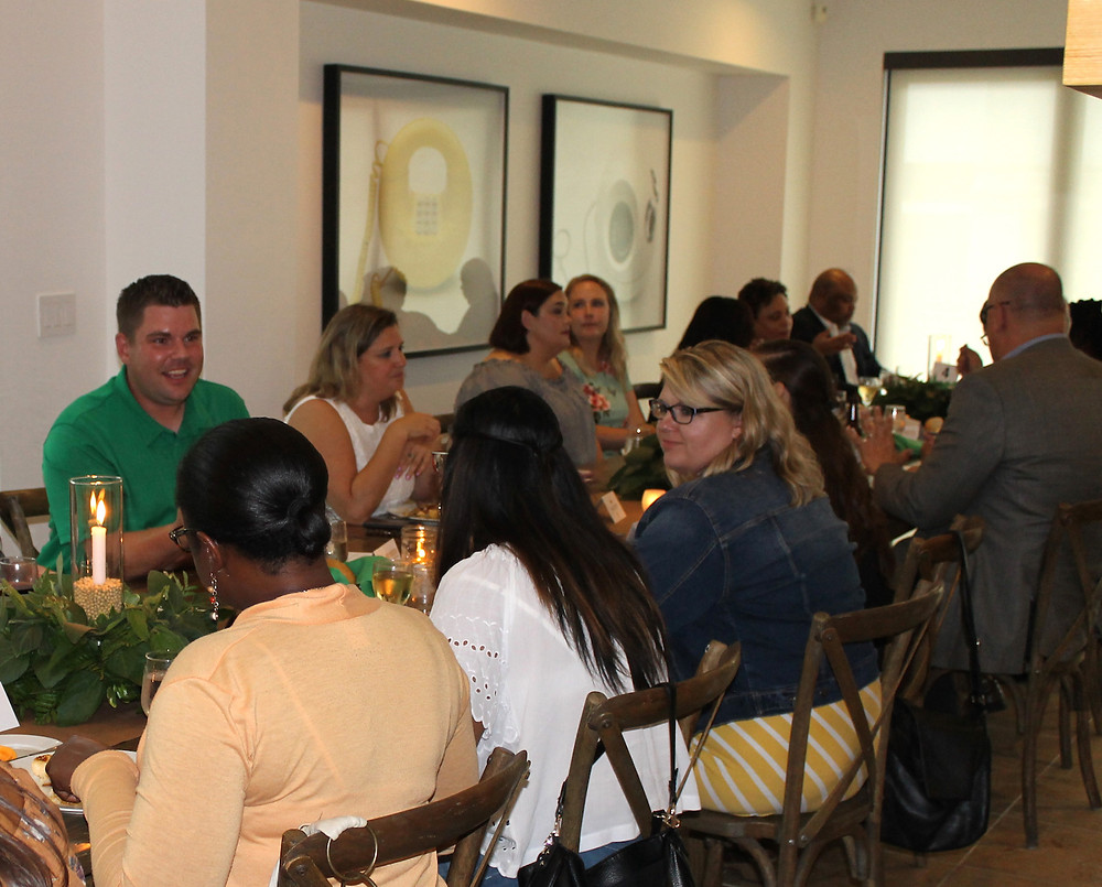 Andrew Roselius, a soybean farmer and Illinois Soybean Association Soy Ambassador from Onarga, Illinois, talks with dinner guests about life on the farm during a soy-inspired farm-to-table dinner at the Museum of Science and Industry Smart Home on Aug. 16.