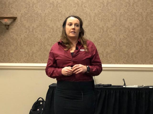 Melissa Kohler of Jenner Ag speaks at a meeting in Bloomington last week / CIFN photo.