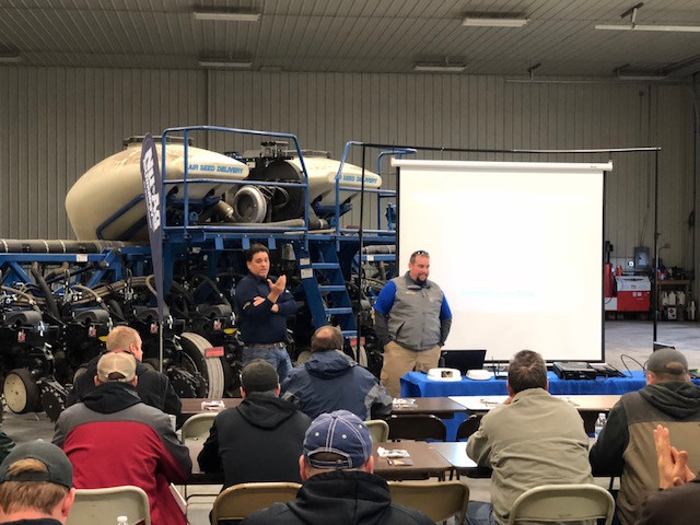 Tim McGreal of Nu-Ag Technology and Ryan Zook of Soil-Max chat with growers / CIFN photo.