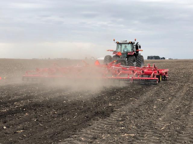 Jason Webster works on the Precision Planting research farm near Pontiac Friday / CIFN photo.