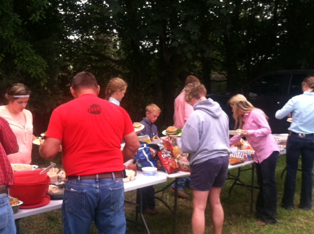 Participants in the Ford County Fair enjoy a complimentary pork burger lunch on Monday / CIFN photo